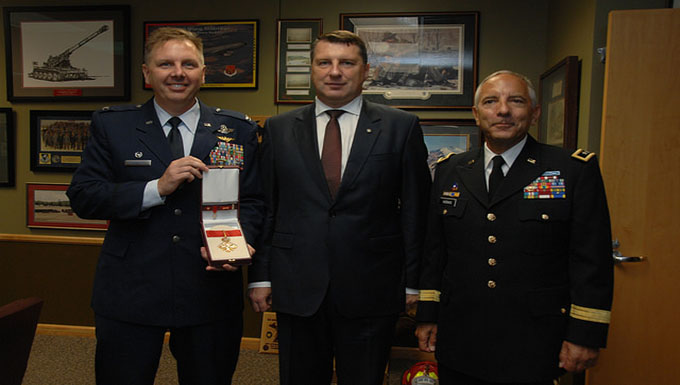 The President of the Republic of Latvia bestows rare medal to Col. J. Andrew Roberts